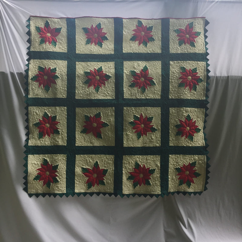 Red Poinsettia Quilt with Prairie Points Edging