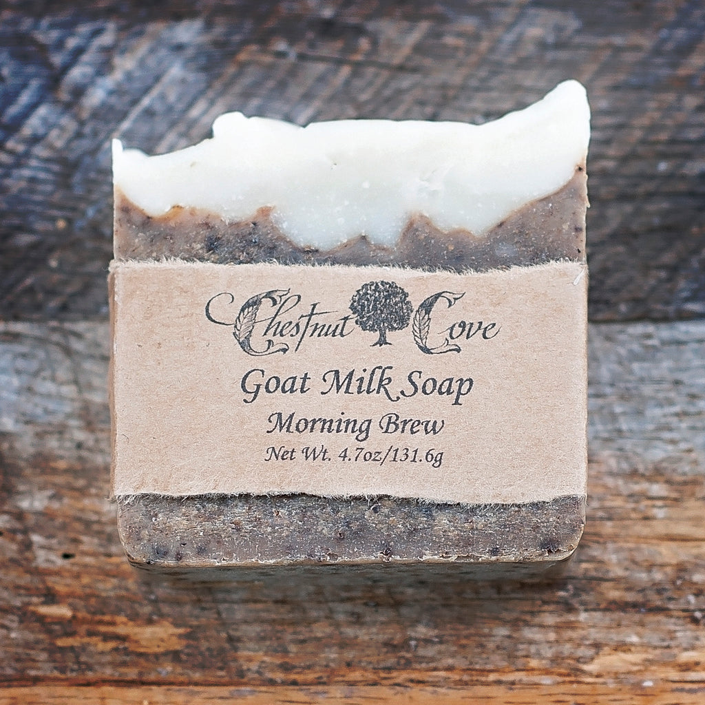 "Morning Brew Goat Milk Soap handcrafted by the Artisans at Chestnut Cove Farm. They even milk their own goats to give you authenticity! Coffee essential oil plus ground coffee for a lovely little scrub. Coffee lovers take note: now you can bathe in it! 4.7 oz. Approximately 3.25"" x 3.25"" x 1""."