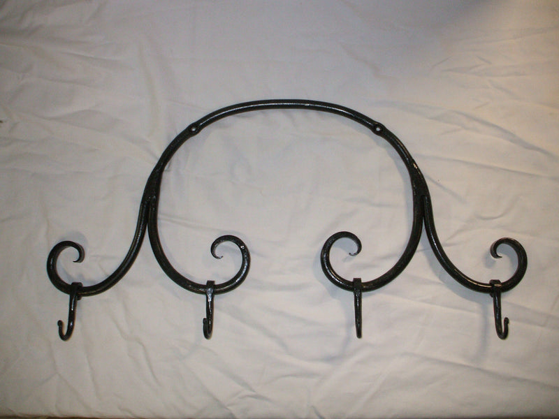 "Hand forged four hook scroll coat rack. Made of iron in the USA. 24.5"" x 13"" x 2.5""."