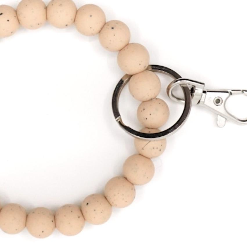 Beige speckled silicone beads