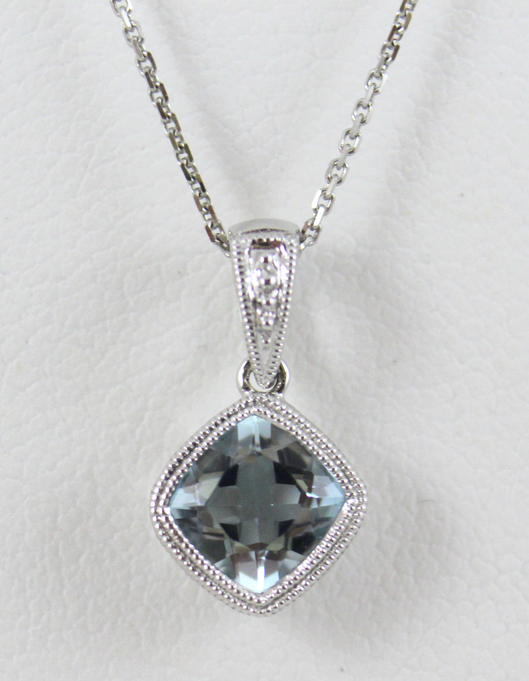 14K White Gold Aqua Pendant on and 18 inch Chain with Lobster Clasp.  One Cushion Cut Aqua=.81ct.