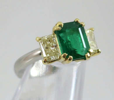 Platinum & 18K Yellow Gold Ring:  AGS Certified Emerald And Two Radiant Cut Light Yellow Diamonds