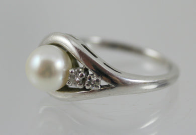14K White Gold Pearl and Diamond Ring.