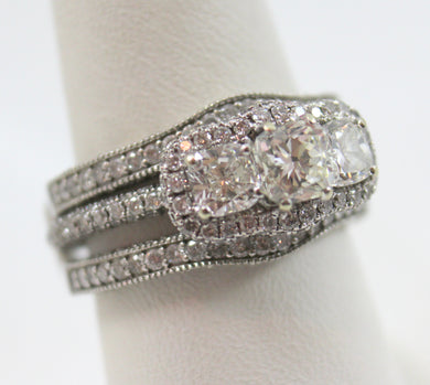 14K White Gold Diamond Engagement Ring & Jacket.  The Engagement ring has one Cushion Cut Diamond weighing Approx 0.75 Carat & two Cushion cut Diamonds weighing Approx. 0.40 Total Carat weight & 172 Round Diamonds