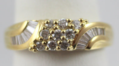 Lady's Yellow Gold 14 Karat Ring Size 6.5 with Approx. 9=0.33Tw Round I/J, SI2 Diamonds & 16=0.32Tw Baguette I, SI1 Diamonds.