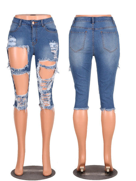 Skinny jeans with big holes