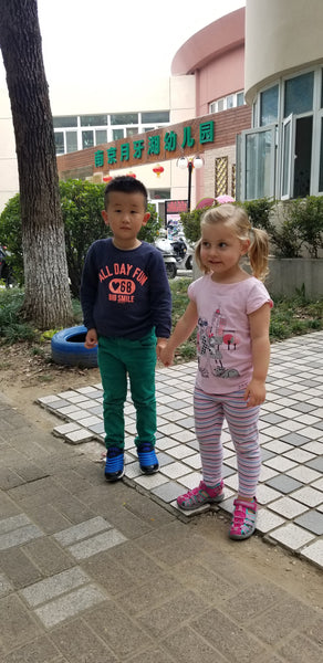 Xaria and her new friend at Chinese Kindergraten, Nanjing China