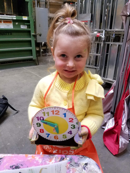 Xaria Proud of Her Finished Clock at a home Depot Kids Workshop