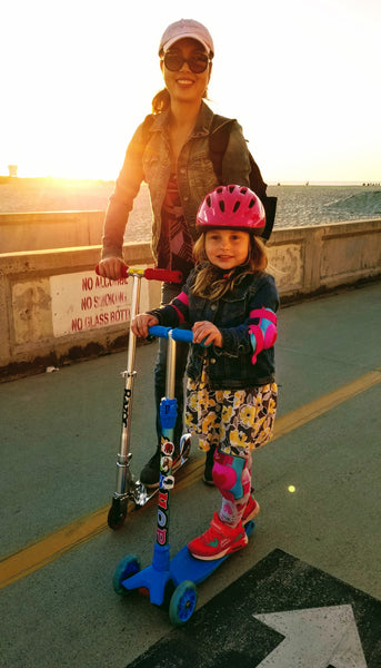 The Girls Scooting Along the Pacific Beach Boardwalk in Southern California