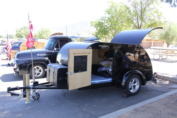 Elegant black teardrop with matching custom truck at the 2016 Lake Perris Teardrop Gathering