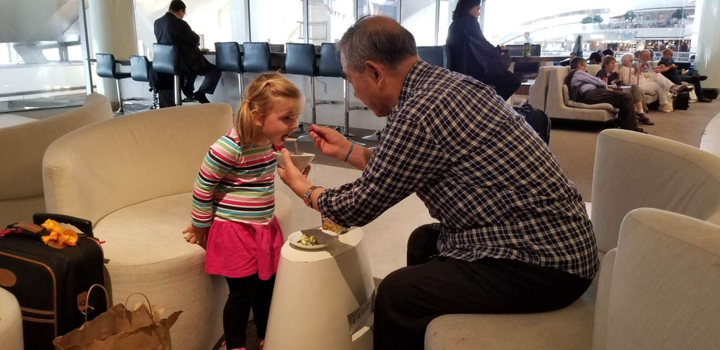 Xaria and Grampy Enjoying a Snack in the China Eastern Lounge
