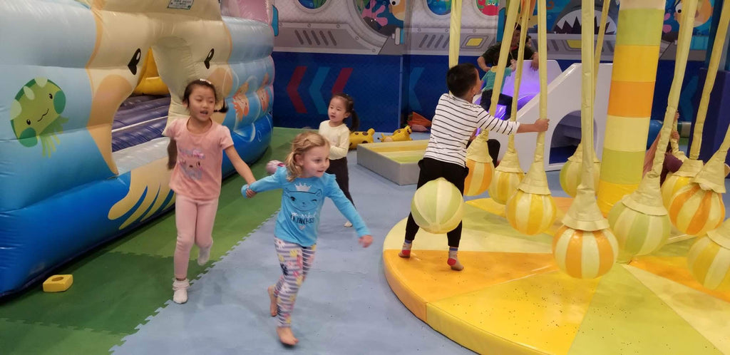 Xaria Playing With Local Children at a Play Area in a Nanjing Shopping Mall