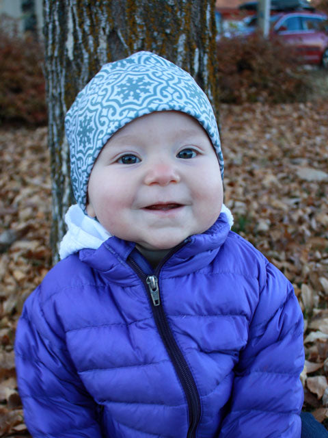 Baby girl wearing grey print winter hat