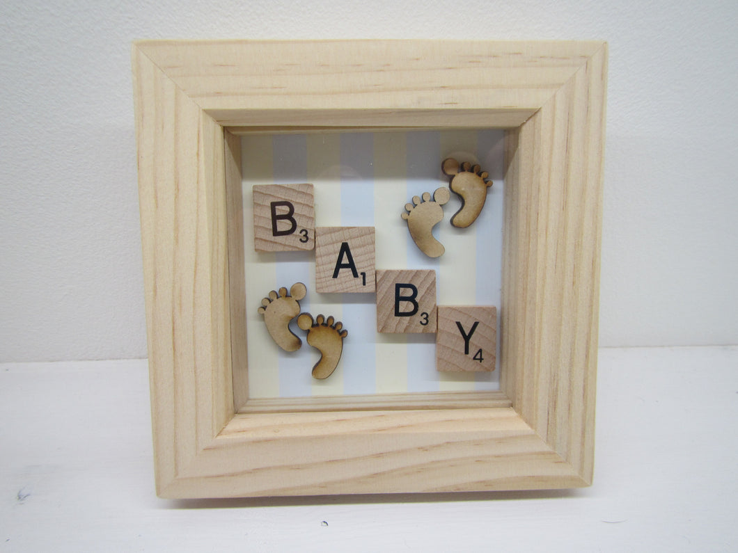 Baby Picture with Scrabble pieces and Blue striped background