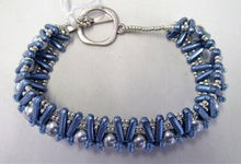 Beautiful handcrafted bracelet with blue beads and pearls, fastened  with a toggle clasp