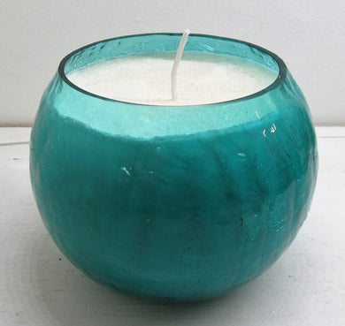 Handcrafted beautiful blue glass pot with candle