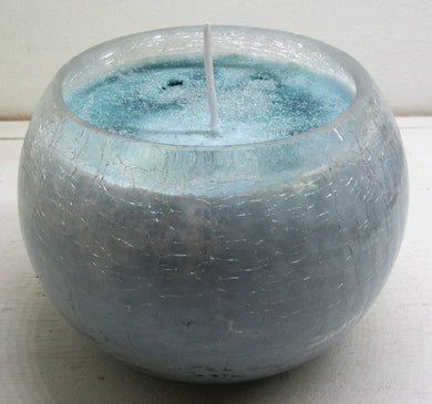 Handcrafted beautiful clear glass pot with blue candle