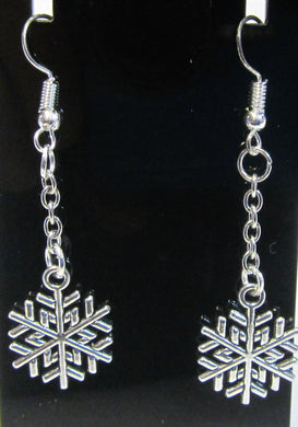 Handcrafted Christmas snowflake earrings on silver plated hooks