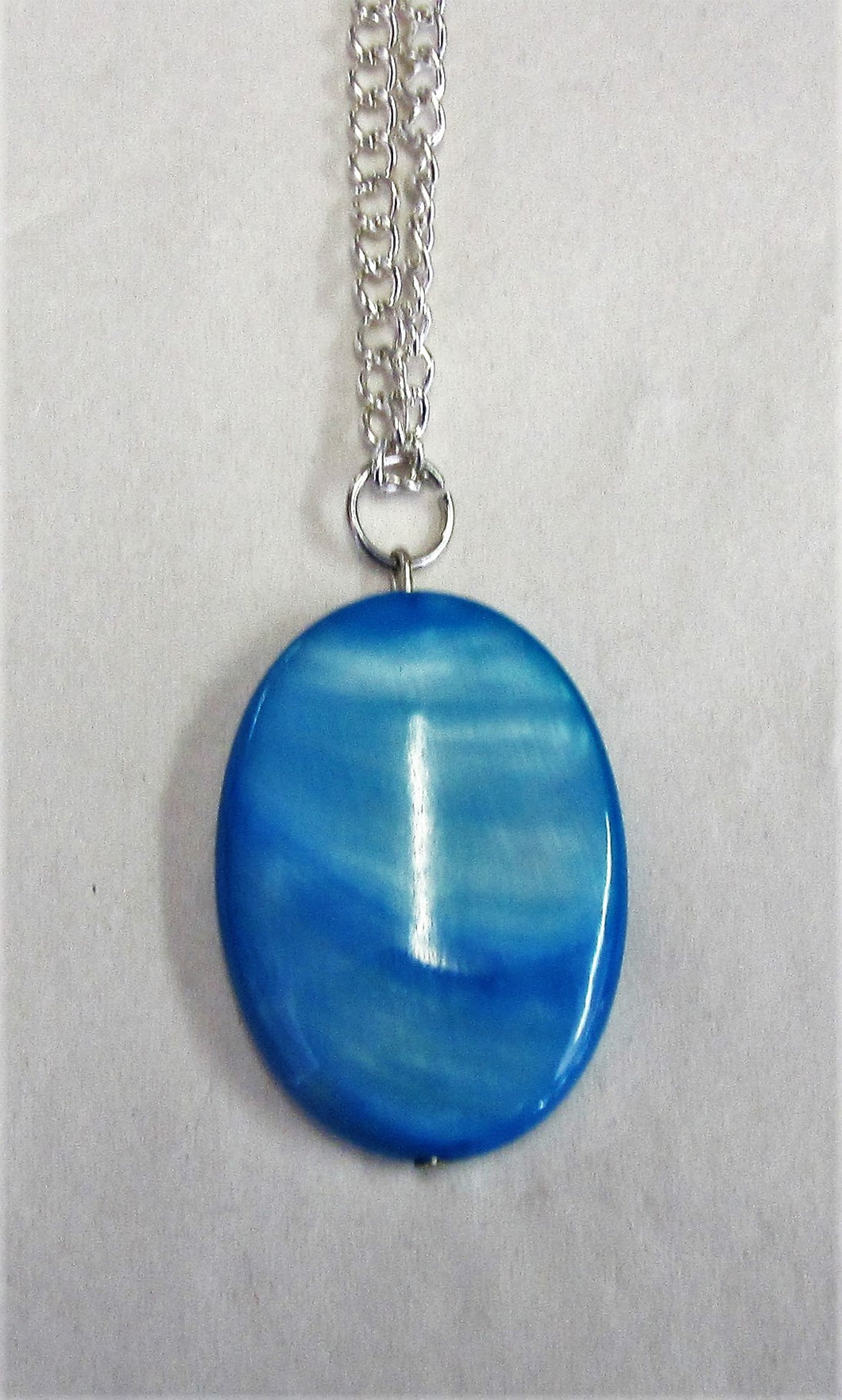 Blue pendent on sterling silver necklace