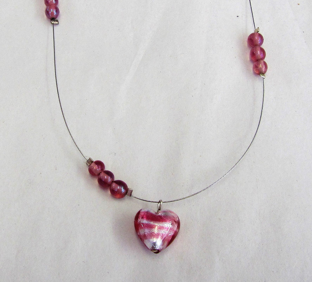Pink heart and bead necklace on wire