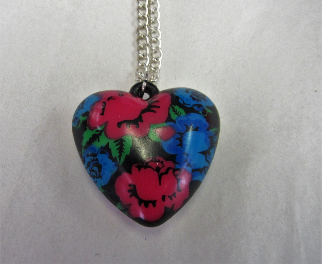 Floral heart pendant on sterling silver necklace