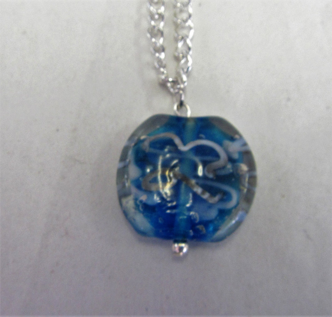 Blue and white pendant on sterling silver necklace