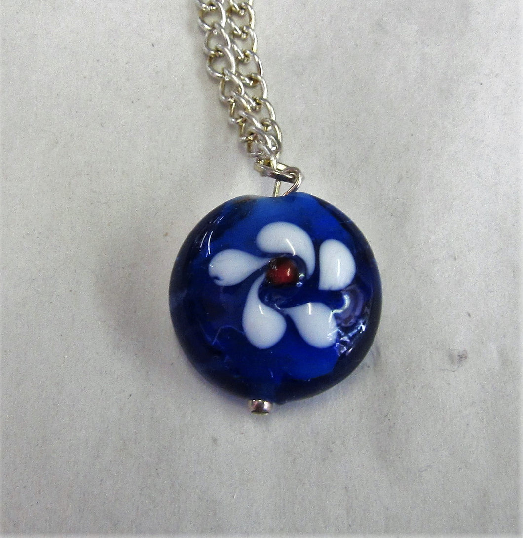 Blue glass flower pendent on sterling silver necklace