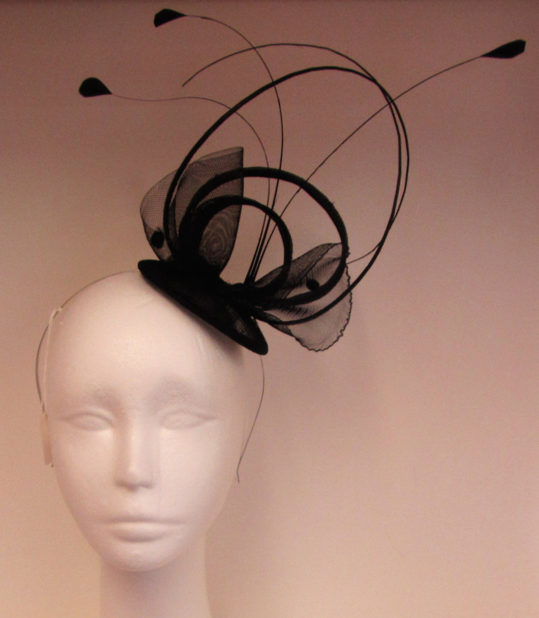 Handcrafted Black fascinator on a hair band