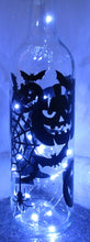 Unique handcrafted Happy Halloween light up bottle with bats and Pumpkins spiders and witches hats