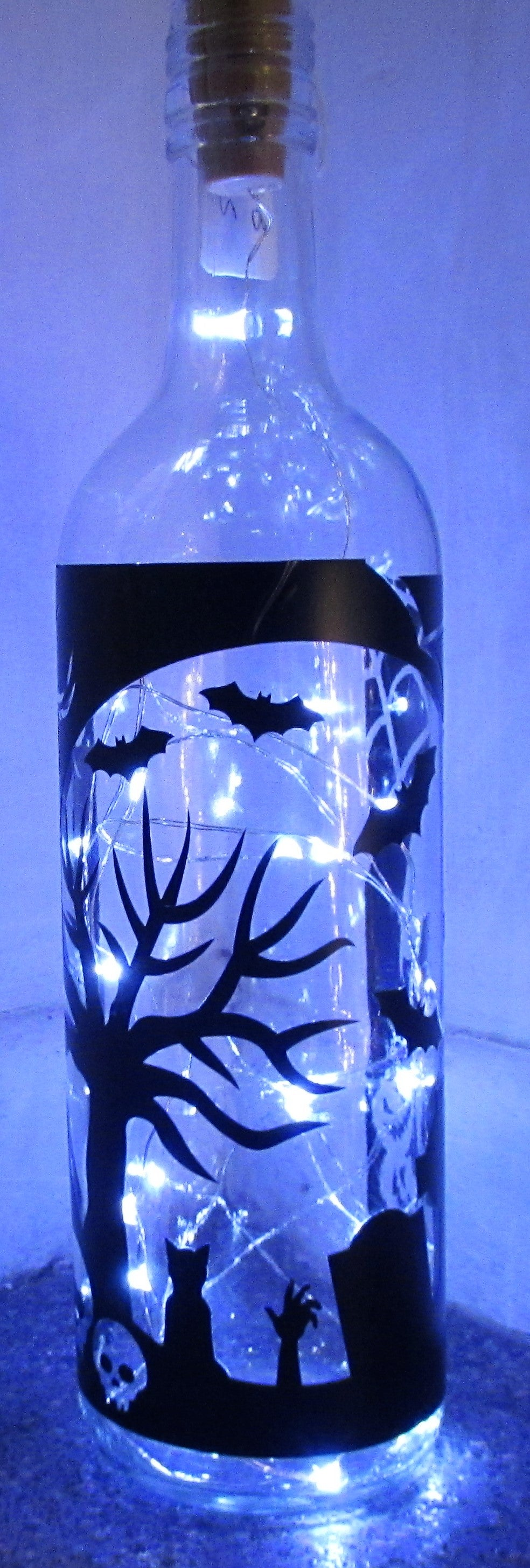 Unique handcrafted Halloween light up bottle with grave yard scene