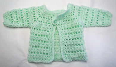 Handcrafted crochet green woollen child's cardigan 6-9 months