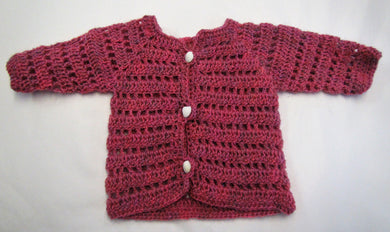Handcrafted crochet pink woollen child's cardigan 6-9 months