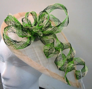 Handcrafted green and cream bows teardrop fascinator on a hair band