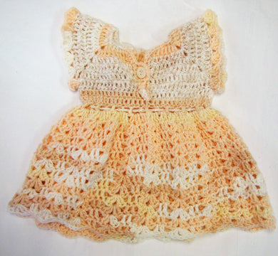 Handcrafted crochet cream and peach woollen child's dress 0 - 3  months