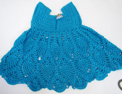 Handcrafted crochet blue woollen child's dress 6 - 9  months