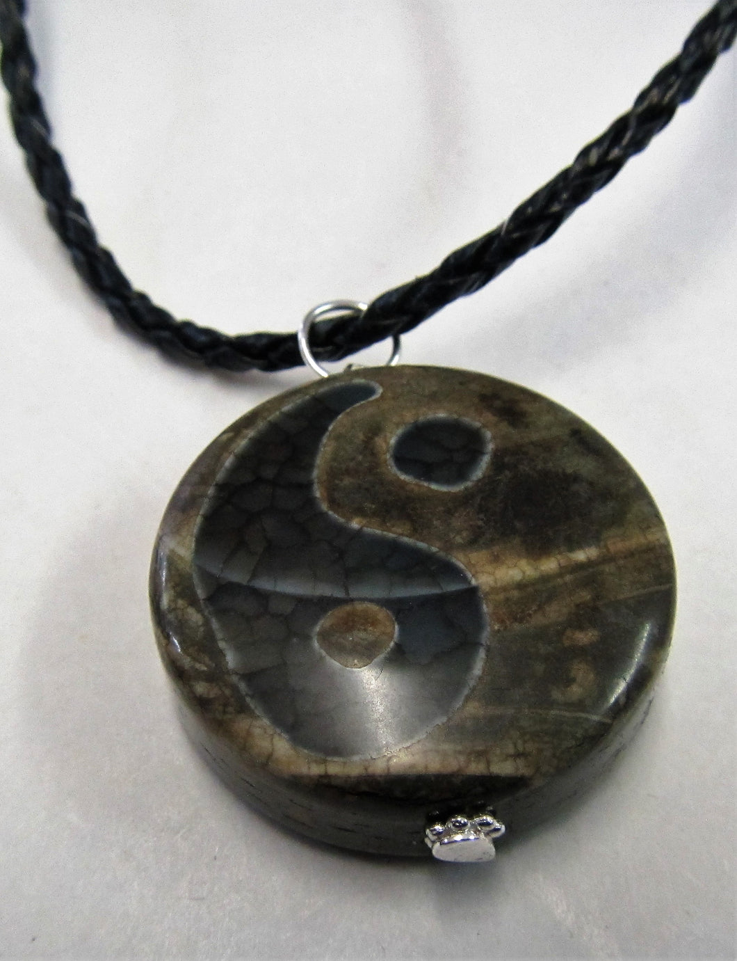 Handcrafted yin and yang agate pendant on leather necklace