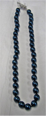 Beautiful handcrafted montana blue swarovski pearl necklace with toggle clasp