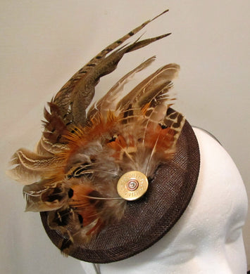 Handcrafted medium pheasant feather with cartridge fascinator on a hairband