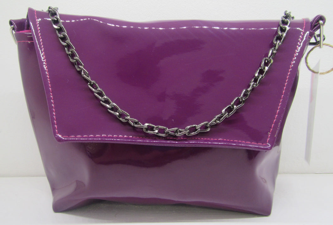 Beautiful handcrafted purple flux fur leather clutch bag
