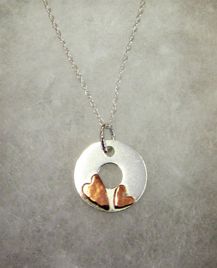 Handcrafted 925 sterling silver disk with hammered copper hearts necklace