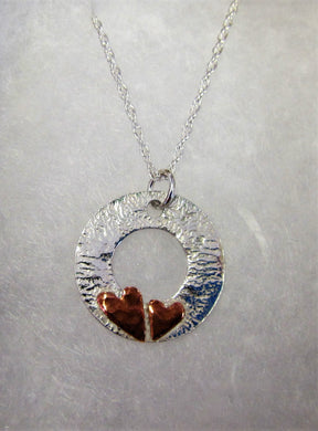Handcrafted 925 sterling silver reticulated disk with hammered copper hearts necklace