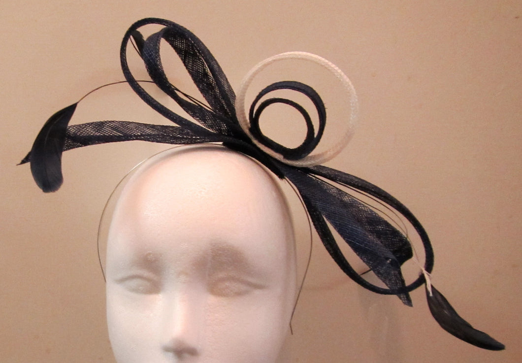 Handcrafted blue and white bow fascinator with blue feathers on a hair band