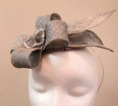 Handcrafted silver fascinator with bow and leaves on a hair band