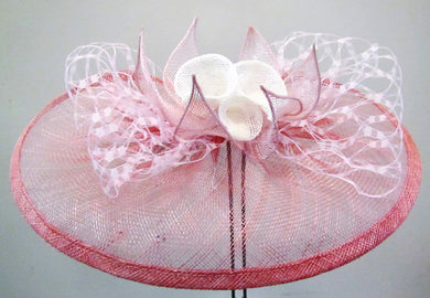 Handcrafted dusty pink fascinator with white lilies and pink leaves on a clip