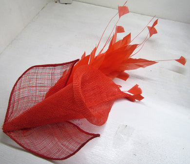 Handcrafted burnt orange Lilly fascinator with burnt orange feathers on a clip