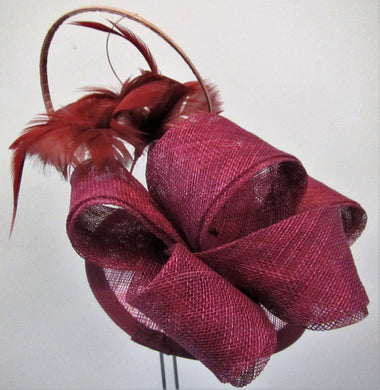 Handcrafted wine coloured bow fascinator with flowers on a hair band or clip