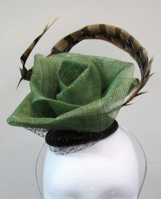 Handcrafted green flower with pheasant feather fascinator on a hair band