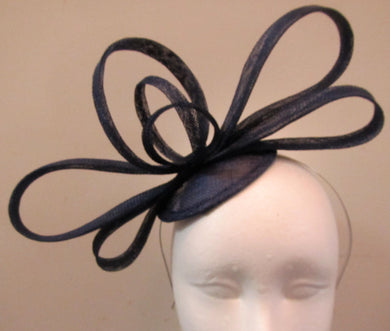 Handcrafted blue bow fascinator on a hair band