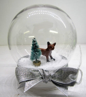 Various beautiful handcrafted snow globes