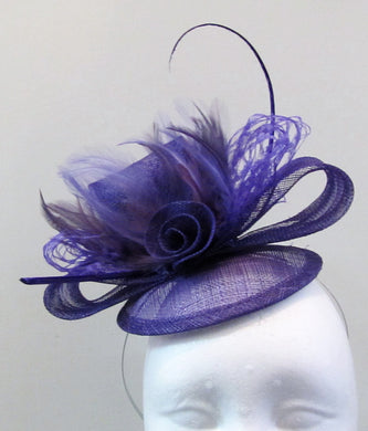 Handcrafted purple fascinator with bow, a flower and purple feathers on a hair band or hair clip